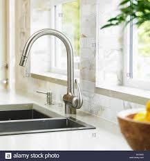 close stainless steel kitchen faucet with marble subway close stainless steel kitchen faucet with marble subway backsplash victoria vancouver island british columbia