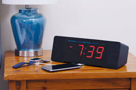 an alexa enabled alarm clock feels like the perfect nightstand