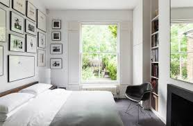 calm mid century bedroom design with nature view from big window