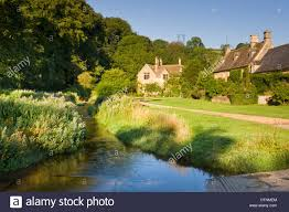 picturesque farmhouses beside the river eye in the cotswolds