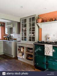 country kitchen with beamed ceiling and rayburn the units are