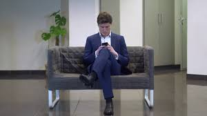young fashionable businessman using smartphone texting message