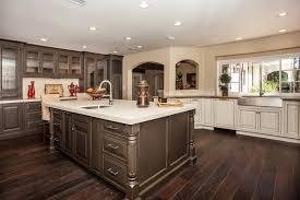 quartz countertops dark wood kitchen cabinets lighting flooring
