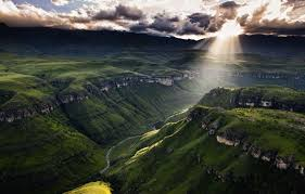 sun shining through the clouds in drakensberg south africa