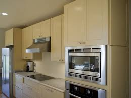 painting unfinished kitchen cabinets how to paint new unfinished kitchen cabinets pictures of painted