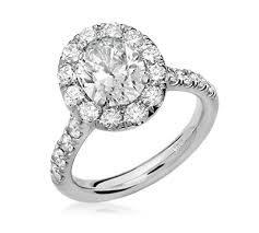 large diamond rings images Oval halo engagement ring with large diamonds png