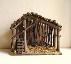 this is a wood manger ready to be set up with your nativity set