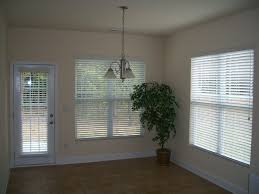 Home Decor Blinds by Decorating Beige Wall With Glass Window With White Faux Wood