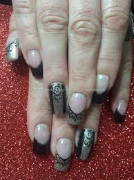 social build acrylic nails with gold and black gel polish and