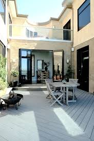 small courtyard designs patio contemporary with swan chairs small courtyard designs patio contemporary with wall lighting