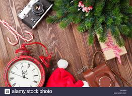 christmas background with camera alarm clock and tree branch on