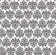 white fabric with black ornaments fabric designs
