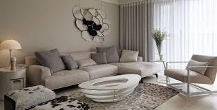broken white color scheme in living room with unique table design