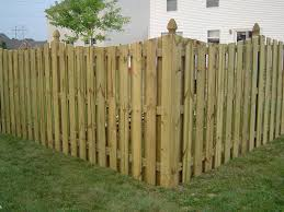 treated shadowbox privacy fence with cape cod style top cut and