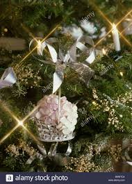 close up of a christmas tree with silver basket filled with dried