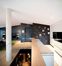 brilliant spanish duplex employs inventive floor plan and a dash