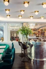 bronte restaurant the strand london featuring tom dixon lighting