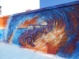 krimsone street art murals surfing beatle