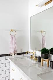 Polished Gold Bathroom Faucets by White And Gold Bathroom Sconces Transitional Bathroom
