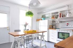ikea white kitchen island how one couple used ikea finnvard trestle legs to make a kitchen