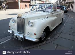 roll royce wedding old white rolls royce wedding car flowers nice stock photo