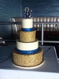 the schumachers had a beautiful wedding cake with blue ribbon