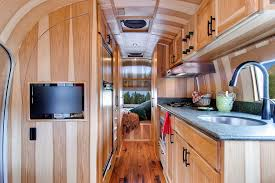 magnificent airstream interior design with wooden furnishing and