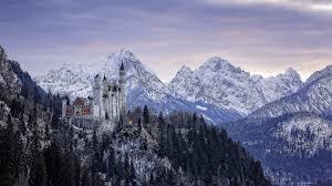 winter landscape background alps and neuschwanstein castle bavaria