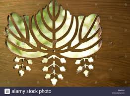 leaf patterns cut out of wood close up stock photo royalty free