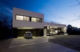 grand bell house by andres remy arquitectos 21 architecture exterior design awesome night view of open car garage and second floor facade beautiful house with warm lighting inspiring swimming pool design