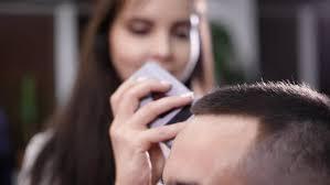 female haircutting videos clipper machine for hair cuts men s hair hair cut hairdresser stock