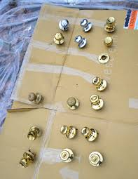 how to paint kitchen knobs how to upgrade your brass door knobs with spray paint