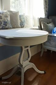 painting a dining room table giving aged patina to a side table