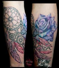 abstract rose with dreamcatcher tattoo on leg