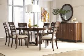 dark brown rustic round dining room table under big white
