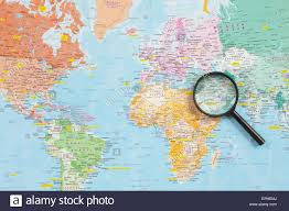 The Middle East Map by World Map And Magnifying Glass Highlighting The Middle East Region