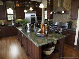 cherry kitchen cabinets with granite countertops green kitchen