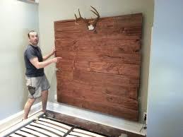diy brown pallet wood wall mount headboard with antler display of