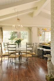 whitewashed beams dining room transitional with round dining table