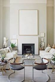 chic elegant living room with taupe molding taupe built ins
