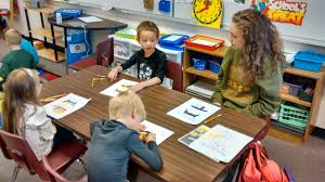 intro to teaching class spends time with elementary students in