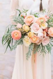 ranunculus bouquet dip dye wedding ideas in ombré and coral garden roses