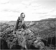 sitting on the rim rock aldo leopold surveys the landscape of the