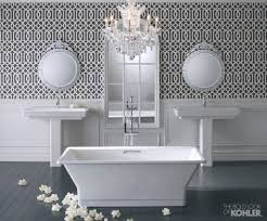 bathroom double kohler sinks and double mirror on wall plus white