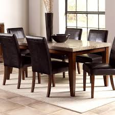 fabulous dining room with formal style featuring espresso round dining