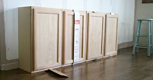 where to buy cheap unfinished cabinets how to create custom built ins with kitchen cabinets