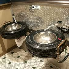 very cool restroom tires for sinks and kegs for urinals