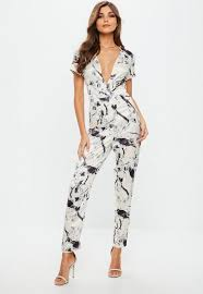 white plunge jumpsuit white silky print plunge jumpsuit missguided