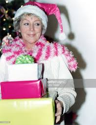 gifts 60 year woman woman 60 years in pink hat with gifts stock photo getty images