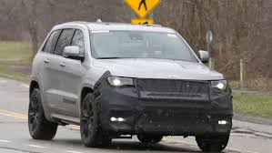 jeep trackhawk grey jeep grand cherokee trackhawk spied hiding extra air intake